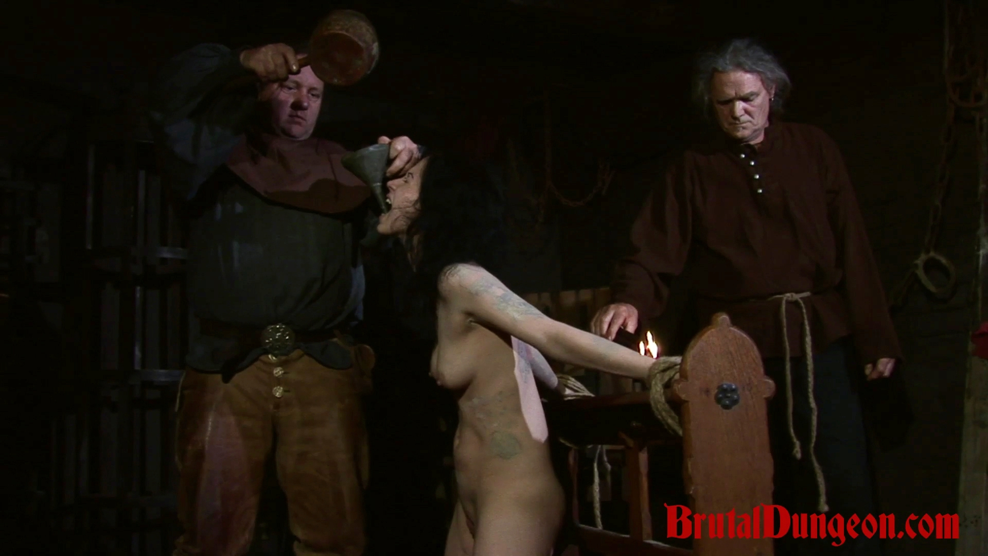 Brunette loredana imprisoned for bdsm gangbang. Brunette whore Loredana has been arrested and punished in our dungeon. She's left without water and begs for only a cup. She will do anything to earn it, even endure imprisonment, rope bondage, domination, BDSM fun, gang bang, candle and wax play, spanking, slapping, flogging, fingering, tit, nipple and cunt torment.