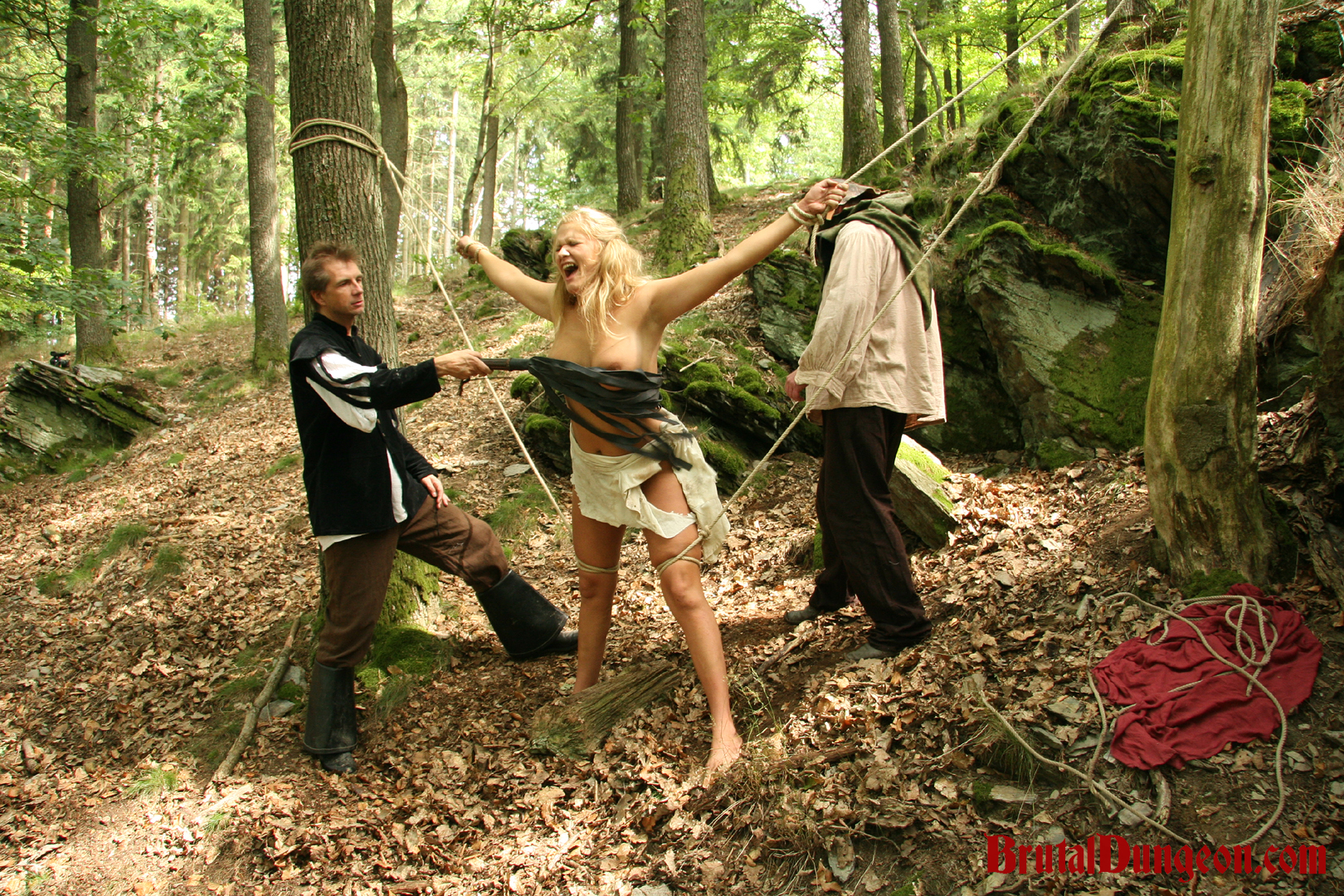 Blonde magda bdsm gangbang. Mighty Blonde Witch Magda is caught conjuring spirits in the forest and punish at once. Our dungeon guards tie her limbs with rough rope to two trees, spread eagle for extreme flogging, imprisonment, BDSM gang bang, outdoor rope bondage, domination, spanking, slapping, fingering, intense breast, nipple and kitty torment.
