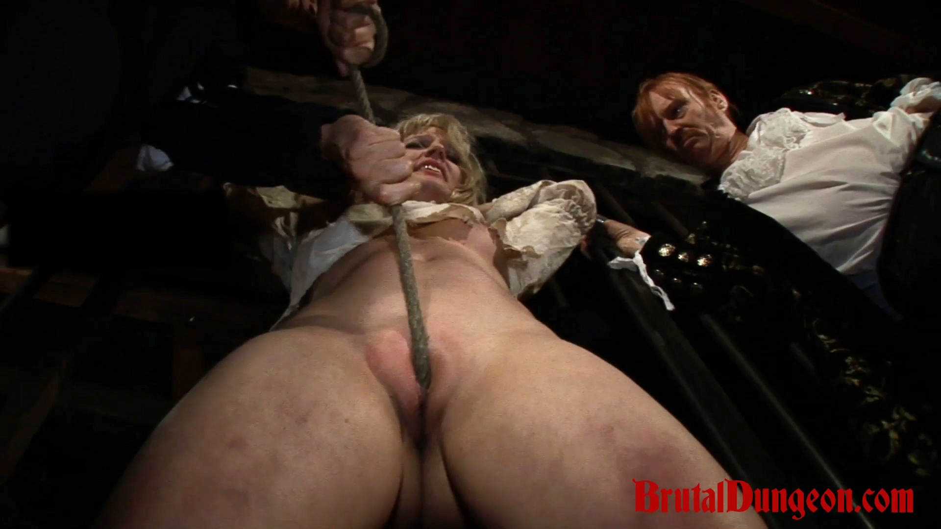 Blonde amalia imprisoned bdsm gang bang. In our dungeon, a young blonde is left begging for a second chance. She is denied and must endure imprisonment, bondage, domination, BDSM fun, gang bang, spanking, fingering, tit, nipple and pussy torment.