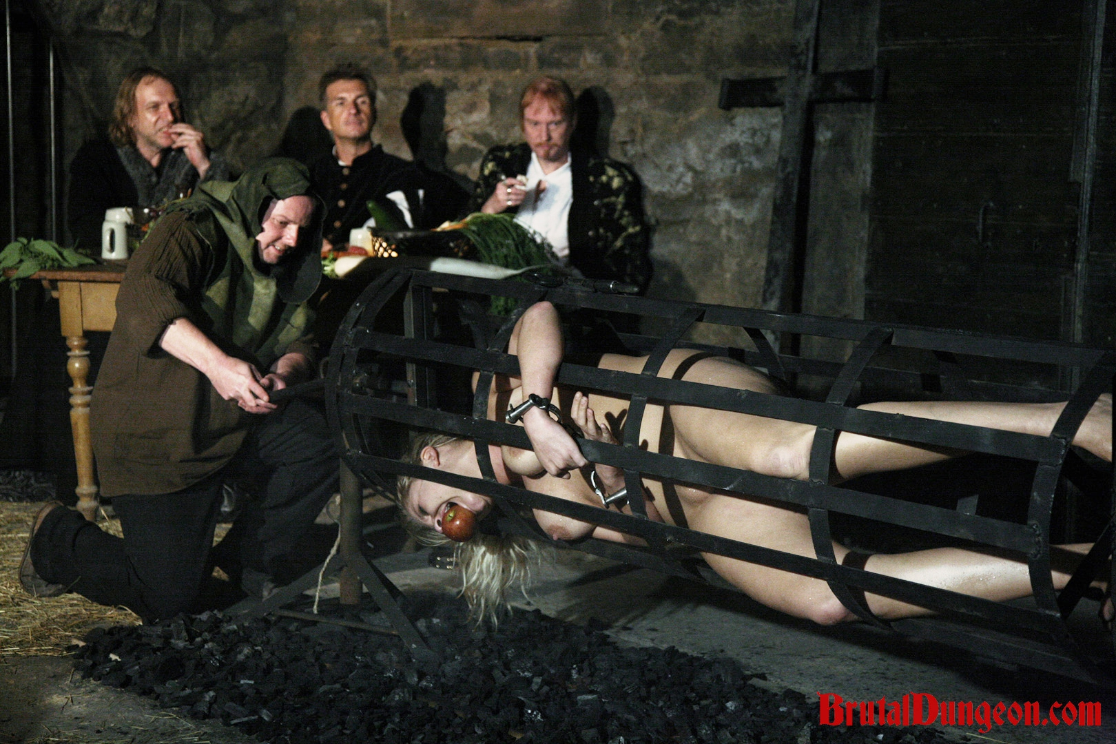 Blonde magda bondage gang bang. Magda, a hot blonde wench the dungeon keepers wanted to play with, was wrongfully arrested and punished. She must endure imprisonment, BDSM fun, bondage, gang bang, spanking, slapping, fingering, extreme food play, triple penetration with tasty vegetables and a ride in a human spit roast.
