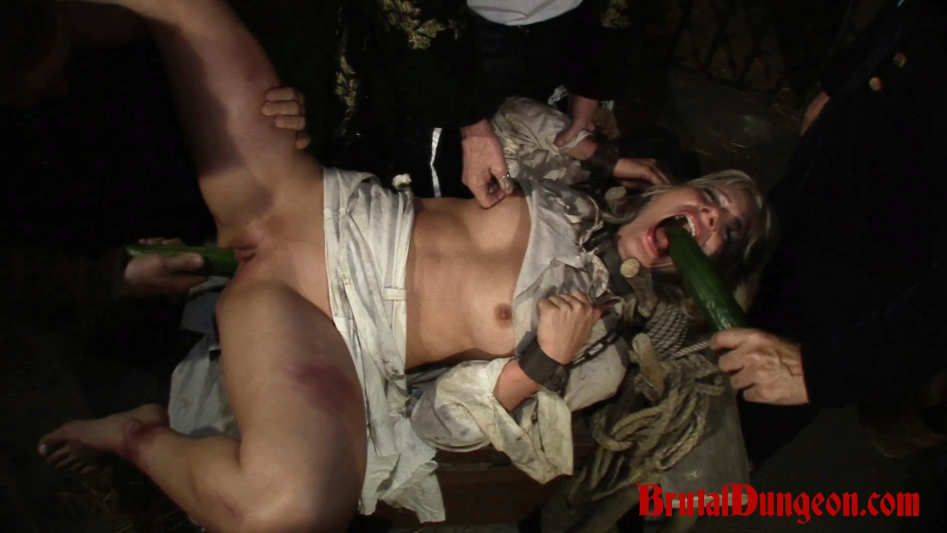 Blonde amalia imprisoned for bdsm gangbang. In our dungeon, a young blonde is left without any food. For some crumbs of bread she would do anything, even withstand any kind of mistreatment to satisfy her Masters. She must endure imprisonment, bondage, domination, BDSM fun, gang bang, food play, food sex, double penetration, blowjobs, spanking, fingering, tit, nipple and cunt torment.