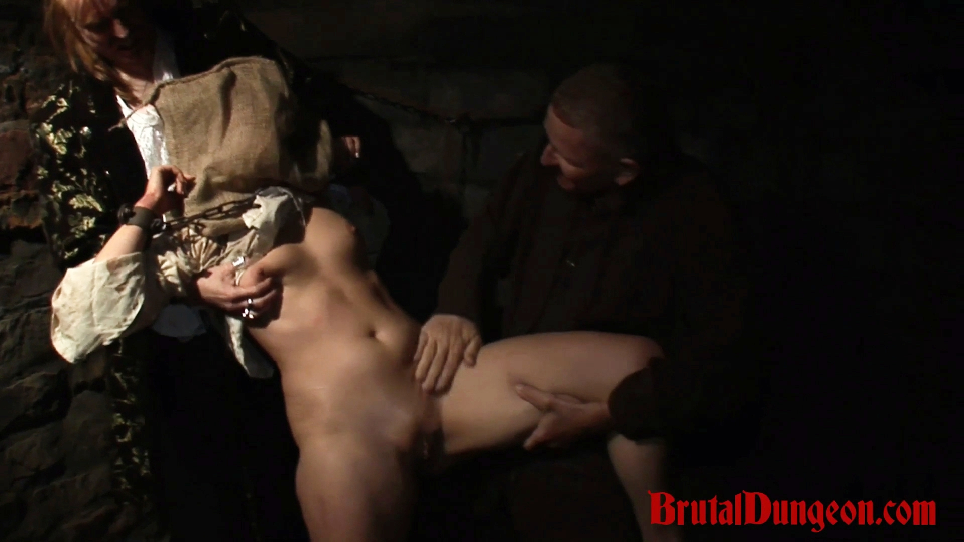 Blonde amalia is for bdsm gang bang. In our dungeon, a young blonde wench is left without any water. For a few drops of water she would do anything, even she will have to stand any kind of mistreatment to satisfy her thirst. She must endure imprisonment, bondage, domination, BDSM fun, gang bang, blindfold, spanking, fingering, tit and pussy torment.